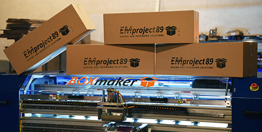 EM Project 89 boxes atop a Box Maker Flexo
